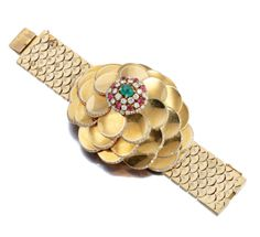 Emerald, ruby and diamond wristwatch/ bracelet, Van Cleef & Arpels, 1940s