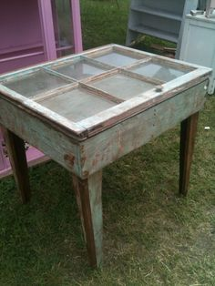 clever display table with old paned window. This would also be cool with family photos in the panes!
