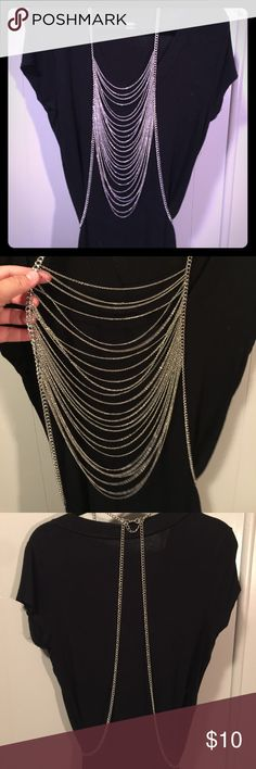 Silver tone Torrid body chain Rock and roll all day in this silver tone Torrid body chain!!! Adjustable/OS. EUC torrid Jewelry Necklaces