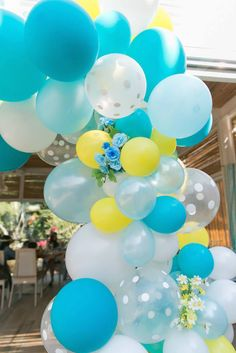 Love this balloon + flower arch! Yellow + Blue Baby Shower via Kara's Party Ideas KarasPartyIdeas.com The Place for ALL THINGS PARTY!