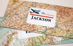 Envelopes made from atlas pages for the boarding pass invitations. Use old flight navigation charts!