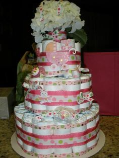 Beautiful Diaper Cake  My sister made one of these when I had my second child.... i loved it. You can be so creative and flexable with it as a gift, and as any parent knows... who doesn't need diapers! LOL