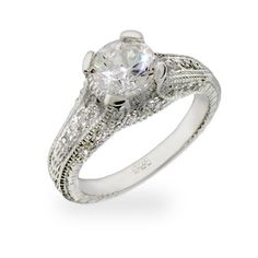 The Celebrity Inspired Brilliant Cut CZ Engagement Ring offers beautiful sterling silver vintage style detailing & a stunning 1.25 carat CZ stone.
