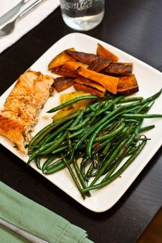 Perfect salmon, green beans with orange, and sweet potatoes wedges.