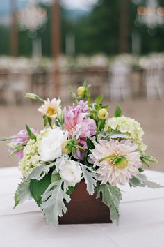 Wooden box #centerpiece with pretty pink florals.  Photography: Green Door Photography - www.greendoorphotography.com/  Read More: http://www.stylemepretty.com/2014/08/18/greenough-montana-wedding-by-habitat-events/