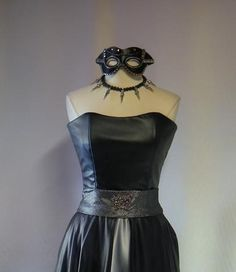For a rocker or biker theme black leather look long dress, silver spike necklace, and masquerade mask meets the need for unique prom and gala nights. #masquerade #rocker #black