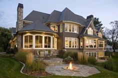 Beautiful stone patio + fire pit.  House isn't too shabby either.