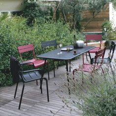 inspiration picture. Black Fermob table with mix of red and black chairs. You can also just do the red chairs with the black table.