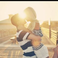 love that they are on a pier, i need a beach setting and that lighting!