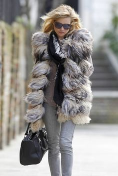Kate Moss dresses a casual outfit with luxurious fur. TopShelfClothes.com