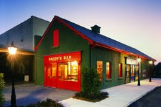 Warm glow from cosy Irish pub in the grounds of Chateau Elan winery / vineyard in Georgia, USA. I photographed this building at dusk, to balance the warm light emanating from the pubs interior with the daylight outside, and shot through a neutral density filter to accentuate the blue sky behind.