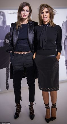 Forget basic T-shirts, simple knits and plain jackets - Carine Roitfeld, pictured right wi...