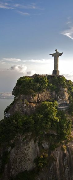 Christ the Redeemer in Brazil is a monument tribute to Christ. More specifically, it represents how Christ loves all. This is show by his open arms showing he embraces everyone. One element of art present is the curved lines used to show the details his clothes and a principle of design is symmetry because there is equal visual weight on both sides from the center.
