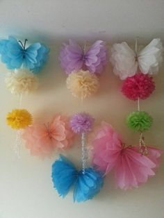 Handmade made to order beautiful butterflies/ pom poms These delightful Pom poms are the perfect decoration to brighten up any room/space to be admired by everyone. They are perfect for childrens birthdays or any special occasions. These pom poms are all handmade as shown in the