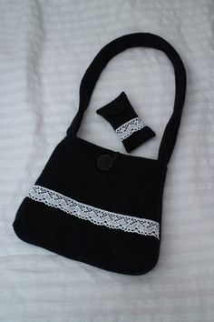 My husband's old woollen sweater turned into a beautiful bag.
