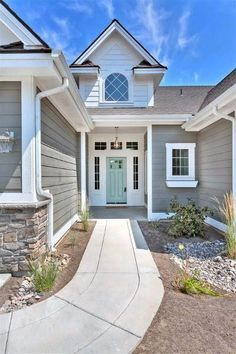 Best Exterior House Paint Ideas & Designs For 2019 Exterior house color schemes can show off detail, minimize poor appearances and increase curb appeal. Selecting the right house paint makes all the difference. Outside House Paint Colors, Stucco House Colors, House Exterior Color Schemes, Paint Colors For Home, Paint Colours, Exterior Paint Color Combinations, Siding Colors For Houses, Grey House Paint, Exterior Gray Paint