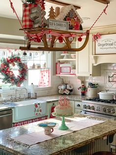Christmas decor in farmhouse style kitchen with vintage sled hanging over the island and a gingerbread baking theme. Gingerbread Christmas Decor, Outside Christmas Decorations, Christmas Room, Retro Christmas, Christmas Mantles, Christmas Living Rooms, Silver Christmas, Victorian Christmas, Christmas Baking