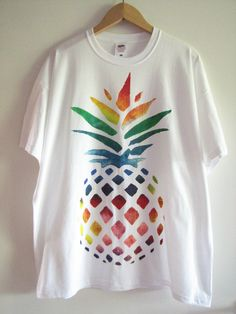 Hand painted t-shirt with rainbow pineapple design   Available sizes: S M L XL   Painted with high quality, non-toxic acrylic paints Washable 100%