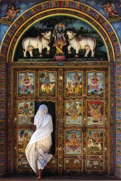 Story through pictures on a door in India. There are also  two sacred cows on the facade above the doors in recognition of entry blessings for those who enter.