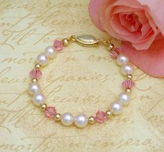 For Hallie, Child's Gold and Pearl Bracelet. White cultured pearls, 14kt gold, and pink sparkling crystals make this a fav.