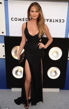 Raising temperatures: Chrissy Teigen looked typically stunning as she hit the red carpet a...