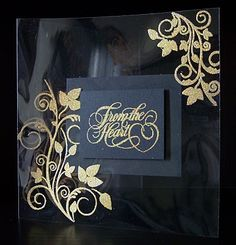 """gorgeous handmade card from """"little princess cards"""" ... clear acetate with gold embossed flourishes in the corners ... panel of black cardstock with gold embossing ... elegantly delightful!!!"""