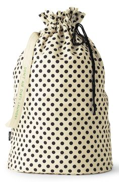 A signature Kate Spade quote styles the strap of this chic-yet-useful laundry bag designed for easy and discreet toting.