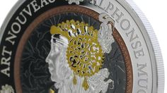 """The first issue 2 ounce gorgeous silver coin of the new series """"Art Nouveau"""" in honor of the artist Alphonse Mucha. Art Nouveau is considered a """"total"""" art style, embracing architecture, graphic art, interior design, and most of the decorative arts. Rose Gold, Yellow Gold and Ruthenium Plating are the special features of this coin, housed in a luxury box with certificate. Mintage only 2.000 pieces worldwide."""