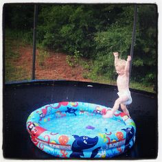This is the BEST idea I have had for my boys yet. Small swimming pool in the middle of the trampoline.