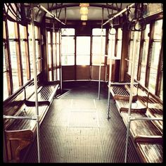 Find an old trolly/subway car and read a book together from that decade. Alt: listen to an album. Get off when the album is over