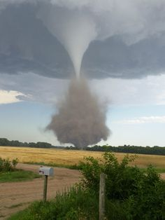'elephant trunk' tornado rips through rural farmland, America.