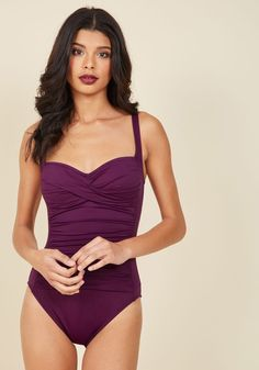 Summer in the Sizzle One-Piece Swimsuit in Plum. Whether youre diving into the local pool or swimming along tropical shores, youll make a stylish splash in this purple swimsuit! #purple #modcloth