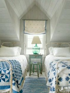 Cottage style design in this cozy attic sleeping space.