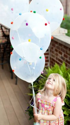 Glue Pom poms on balloons!!