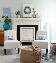 Make your fireplace stand out every season by using black-hole fireboxes that boast personality. Here, a good-looking vintage tin ceiling tile stands tall in a custom-built footed frame.