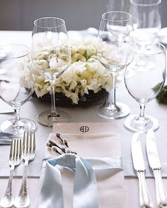 a simple ribbon tied around the napkin - the flower sprig is a nice touch