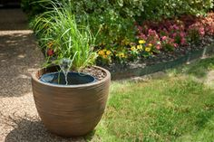 Make your walkway more welcoming with these #smartpond DIY planter fountains! #diygardenprojects