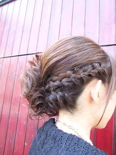 Two french braids into messy side bun