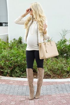 Super cute way to wear my faux fur vest. White J Crew Tee, Black Leggings, Cream Color Boots. Perfection!