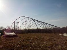 """This is the first of three """"high tunnels"""" at the Willowsford Farm. Tunnels give the farm a jump on the summer growing season. This one will be home to early tomatoes, peppers, and basil. We can't wait to see the results! www.willowsfordfarm.com"""