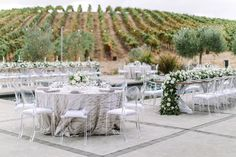 La Tavola Fine Linen Rental: Baylis Rain Silver with Velvet Dove Napkins | Photography: The Edges Wed, Event Planning & Design: A Savvy Event, Florals: Nancy Liu Chin Designs, Venue: The Glass House, Catering: The Girl & The Fig Caters, Rentals: Theoni Collection and Encore Events Rentals
