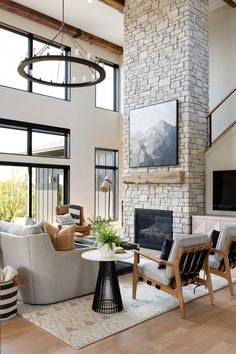 Living room with floor-to-ceiling windows and a floor-to-ceiling stone fireplace Afton, MN Living Room Windows, Home Living Room, Living Room Designs, Living Room Furniture, Living Room Decor, High Ceiling Living Room Modern, Home Fireplace, Living Room With Fireplace, Fireplace Design