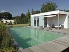 natural pool with stainless steel waterfall