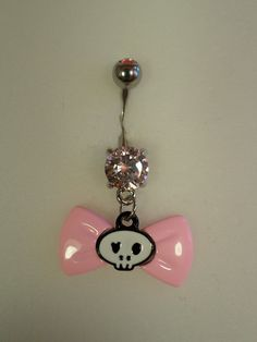 pink bow with skull dangle navel ring with pink by Jewellnine, $5.00
