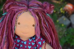 """This is Lindsay, a Bamboletta Sitting Friend.  She has sunkissed skin, long hair made with mohair and wool yarns in a burgundy color with two varieties of multicolored fairy bits and brown eyes.  She is wearing the pictured outfit, underpants and wool crochet shoes. These dolls measure approximately 15"""" in height.  They are hand made with wool, cotton, and lots of love.  They are softer than the regular 15"""" dolls and have flexible limbs."""