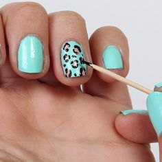 Show Your Spots: Take a gold or silver metallic polish and do 6 or 7 irregular-sized dots on your nail, including one dot directly over the chip. Next, use a toothpick dipped in black polish to outline half of those irregular dots. Apply top coat to finish this leopard look. #FIERCE