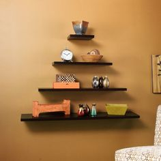 Cool Pyramid Black Teak Floating Shelves Design Ideas Also Clock And Unique Accessories As Well As Cozy Brown Wall Paint