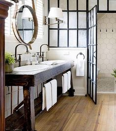 """The Mixmaster: @beckiowens -- Perfectly blending timeless traditional and bright midcentury styles with touches of rustic ease, this Southern California-based designer's feed has something for everyone, like this industrial meets farmhouse master bathroom. See more design ideas and inspiring interiors on """"21 Must-Follow Insta Feeds for 2016"""" on the One Kings Lane Style Guide!"""