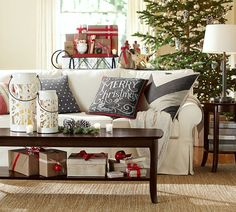 Endearing Pottery Barn Christmas Ornaments With White Fabric Upholstered Sofa Including Dark Brown Wooden Rectangle Table Above Cream Floor Rugs And Brown Wooden Round Table Near Sofa Also Green Pine Leaf Christmas Trees On The Brown Wooden Floor With Pottery Barn Dining Tables  Also Pottery Barn Outdoor Pillows , Entrancing Design Ideas For Pottery Barn Christmas Decorations: Interior, Living Room