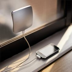 Solar powered USB charger that sticks to the window for optimum sun